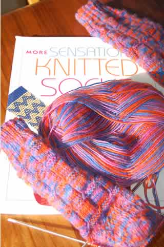 "neon Opal and Charlene Schurch's book, ""More Sensational Knittd Socks"" which coincidentally, has about the same color scheme as the Opal yarn in the title"